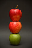 Apple Exception. A line of apples with one exception Stock Images