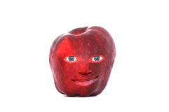 Apple Face. A fun face in a red apple royalty free stock image