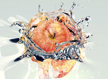 Apple faling and splashing into water Stock Images