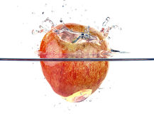 Apple faling and splashing into water Stock Image
