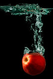 Apple Falling To Water Royalty Free Stock Photography