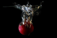 Apple falling into water Royalty Free Stock Images