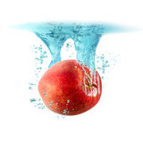 Apple falling into the water Royalty Free Stock Photos