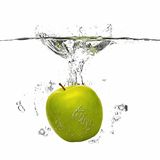 Apple falling into the water with splash on white Stock Photography