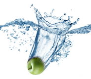 Apple falls deeply under water royalty free stock photos