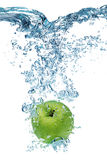 Apple falls deeply under water Stock Images