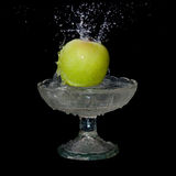 Apple falls into water Royalty Free Stock Photos