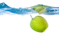 Apple fell into the water. Close-up Stock Photos