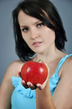 Apple in female hand Royalty Free Stock Photo