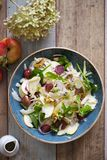 Apple and fennel salad with walnuts and greens. Fresh apple and fennel salad with walnuts, onion and greens stock image
