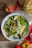 Apple and fennel salad with walnuts and greens. Fresh apple and fennel salad with walnuts, onion and greens stock photo