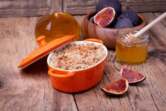 Apple and figs crumble on wooden background Royalty Free Stock Photos