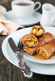 Apple-filled crepes Stock Images