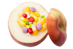 Apple filled with drugs concept Royalty Free Stock Image