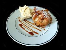 Apple in Filo Parcel. Apple in filo pastry dusted with icing sugar and served with vanilla ice cream and caramel sauce Stock Images
