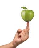 Apple on finger Stock Image