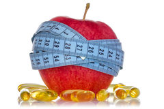 Apple and fish oil pills Royalty Free Stock Photo