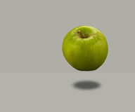 Apple Floating. Granny Smith apple Floating on gray background Stock Images