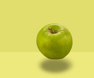 Apple Floating. On yellow background Royalty Free Stock Image