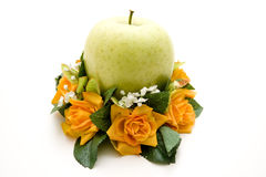 Apple in the floral decoration Stock Photo