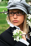 Apple flower. Portrait of girl holding apple tree branch with white flowers Stock Image