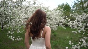 Apple flowers. spring. cloudiness. woman. girl. dress. white dress