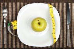 Apple  on food plate Stock Image