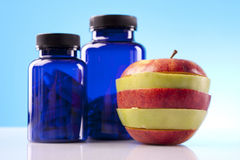 Apple, Food Supplements, capsules Royalty Free Stock Images