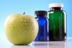 Apple, Food Supplements, capsules Royalty Free Stock Photography