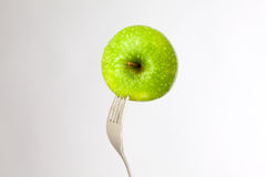 Apple and fork Royalty Free Stock Image