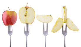 Apple on a fork Royalty Free Stock Image