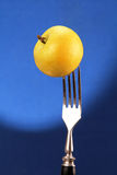Apple on a fork. Royalty Free Stock Photos