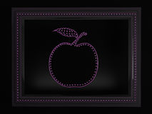 Apple in a framework Royalty Free Stock Photography