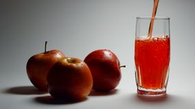 Apple fresh juice with red apples. stock video footage