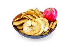 Apple fresh red and slices of dried in bowl Stock Photos