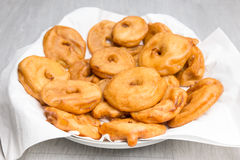 Apple fritters on scale Royalty Free Stock Photography