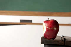 Apple in front of blackboard Royalty Free Stock Photography