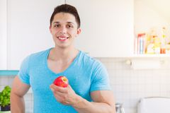 Apple fruit healthy eating young man eat copyspace Stock Images
