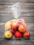 Apple fruit in plastic bag stock image