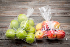 Apple fruit in plastic bag royalty free stock photo