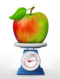 Apple fruit on scale pan Royalty Free Stock Images