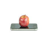 Apple Fruit and smart phone Isolated on white Royalty Free Stock Photo