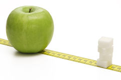 Apple gegen Zucker Lizenzfreie Stockbilder