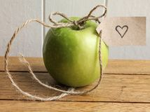 Apple gift from the heart Stock Photos