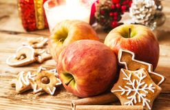 Apple, Gingerbread and Spices with Christmas Decoration Royalty Free Stock Photos