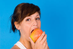 Apple and a girl Royalty Free Stock Image