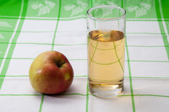 Apple and a glass of apple juice on the table Stock Images