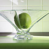 Apple in glass dish. Green apple in glass dish Royalty Free Stock Images