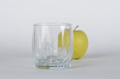 Apple with glass. Green apple with empty glass background Stock Photo