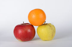 Apple with glass. Green, red apples and orange on white background Stock Images